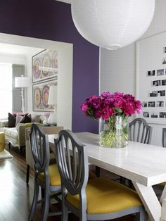 purple dining room with gray & yellow chairs