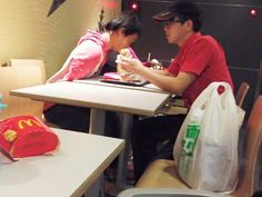 This beautiful image of a McDonald's worker assisting a disabled customer with their food has melted heart online.