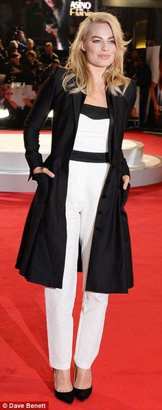 Monochrome magic: Margot opted for a simple but chic outfit as she donned a black and whit...