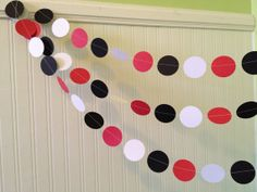 @Erin Rodriguez @Megan Do you think this looks cheap? Paul isn't a fan of these but I think they are cute. Red and Black paper Garland Birthday Party by ClassicBanners, $10.00 birthday garland - red and black decorations