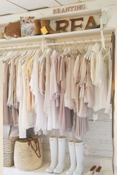 Lovely store display area or perhaps it's some lucky girl's closet space. White, white, white!