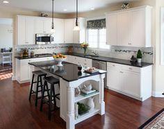 white kitchen cabinets with black granite countertops