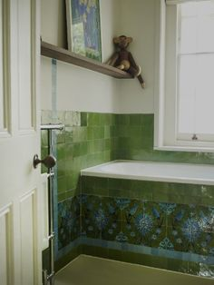 Children's bath done in shades of blue & green tiles in glazed traditional & handcut Morrocan, designed by Retrouvius Reclamation and Design