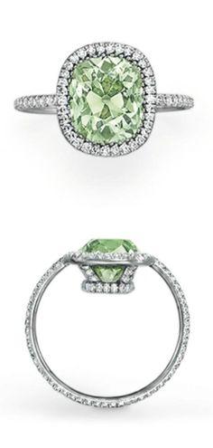 A 15.75-carat vivid yellow diamond in a diamond pavé-set platinum ring by JAR