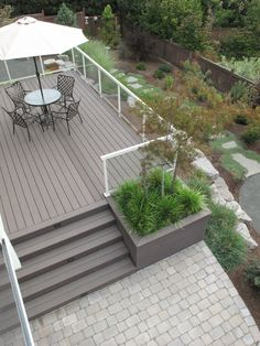 Planter adjacent to stairs. Composite Deck with Built In Planter by Landscape East & West, Portland, Oregon. Patio Steps, Backyard Patio Designs, Backyard Landscaping, Raised Patio, Raised Bed, Deck Stairs, Composite Decking, Land Scape, Beautiful Gardens