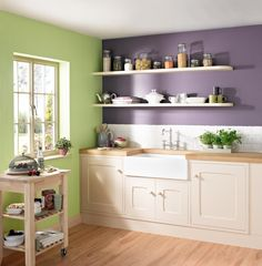 Crown Kitchen & Bathroom paint in Olive Press (green) and Lola Plum (purple). Belfast sink, country-style kitchen