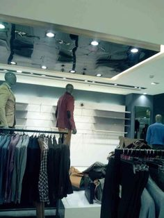 Retail Store with Hanging Clothes Rack and Cob lighting by Assetmax Interiors, Contractor in Delhi, India