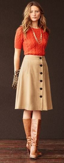 pretty outfit with orange knitted sweater, tan A-line skirt and classic leather boots