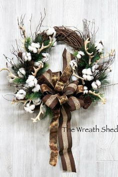 Rustic farmhouse style grapevine wreath with cotton, antlers, evergreen and brown copper burlap ribbons. #rustic #farmhouse #deer #antlers #woodland #cotton #grapevine #wreath #christmas #holiday #promoted #etsy