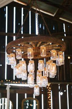 Mason Jar Wagon Wheel Wedding Chandelier for Rustic Barn Weddings / http://www.deerpearlflowers.com/rustic-country-wagon-wheel-wedding-ideas/
