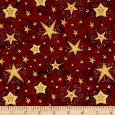 Santa's Big Night Swirl Stars Red from @fabricdotcom  Designed by Debbie Mumm for Wilmington, this cotton print fabric features festive stars and is perfect for quilting, apparel and home decor accents. Colors include black and shades of red and gold.