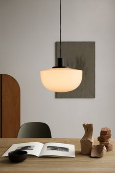 Danish brand Menu has combined a large hemispherical glass shade with fine metal fittings in a minimalist pendant light created by Copenhagen design studio Norm Architects. Pendant Chandelier, Chandelier Lighting, Shop Lighting, Lighting Design, Task Lighting, Design Studio, House Design, Plywood Furniture, Furniture Decor