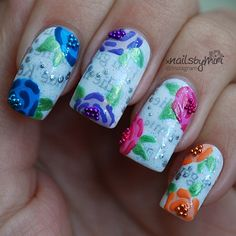 Colorful roses and newspaper nailart. Instagram photo by @xnailsbymiri via ink361.com.