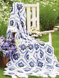 Sweet lavender flowers accent the framed motifs on this tasseled afghan, made with worsted weight yarn and sizes G and H hooks. About 53 x 74 inches. Designed by Brenda Stratton
