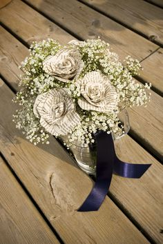 I really loved making my own wedding bouquet. handmade paper flowers and gypsophilia, tied with navy blue ribbon.