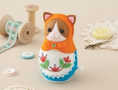 Orange cat felt wind-up doll kit.  Also pink rabbit and red bear.