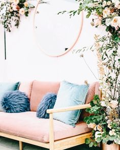 decor | flowers | bohemian | pink sofa | couch | blue cushions | round mirror | plants | chic
