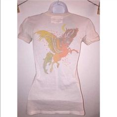 Pegasus T-Shirt Adorable top with stars printed on the front and a Pegasus printed on the back. Light piling and one small yellow stain at scoop neck, shown in last pictures. Size says one size fits most but it will fit best for a xsmall or small. Tops Tees - Short Sleeve