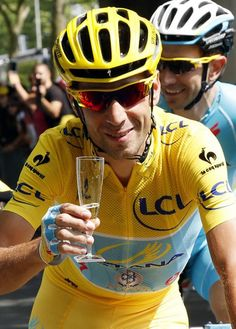 Nibali enjoys a well-derserved glass of champagne during the Tour de France finale