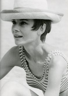 Audrey Hepburn in a summer hat and stripes.