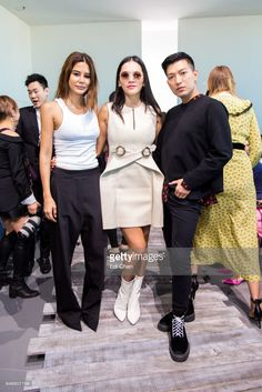 Christine Centenera, Tina Leung & Bryan Grey Yambao attend the Michael Kors runway show during New York Fashion Week at Spring Studios on September 13, 2017 in New York City.