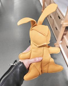"192 Likes, 10 Comments - Gabriella Buzas (@epicstreetstyle) on Instagram: ""Nice catch 🐇 . ."" yellow leather rabbit and other stories oversized bag charm cool shopping"