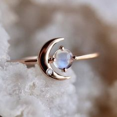 Instead of wishing upon a star, we're carrying ours with us wherever we go. A stunning statement ring featuring a moonstone orb framed by a crescent moon and set in solid 14K rose gold. A truly inspiring piece to gift a friend or loved one. Solid 14K rose gold Natural 4mm rainbow moonstone Prong set moonstone Flush se