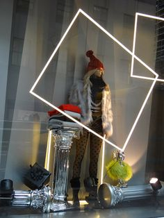 +Geometry in Window Displays+ Simple large lighted squares frame the mannequin giving this window more visual impact. H&M NYC Winter 2013.