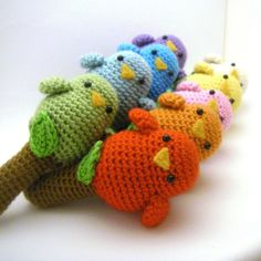 Rainbow amigurumi birdies... maybe a small Easter egg inside with popcorn kernels for a rattle.