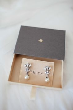 Pearl earrings. BHLDN.  Photography: The Nichols - jnicholsphoto.com  Read More: http://www.stylemepretty.com/2014/01/10/al-fresco-austin-wedding/