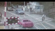 Shocking video shows cyclists ignoring level crossing barriers in Cambri...