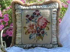 A soft vintage green needlepoint pillow