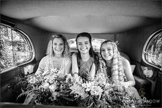 Bride and daughters in wedding car on the way to highgate house wedding venue.