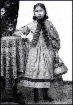 The only child saved out of the Sand Creek Massacre 1864, was a young Arapaho girl raised by Miss Ford, Central City. Photo taken c1870.