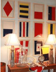 This is made out of vintage nautical flags but wouldn't it be fun to reproduce this with nautical scrapbook paper :D. Wall outside of master Nautical Flags, Nautical Design, Nautical Home, Nautical Letters, Vintage Nautical Decor, Nautical Colors, Vintage Flag, Nautical Nursery, Coastal Living