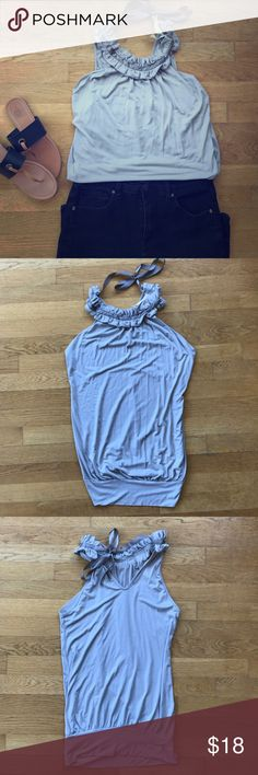 Elegant gray halter This gray halter top is great with a pencil skirt or a pair of black skinnies. The ribbon tie at the neck makes this piece so elegant. 94% rayon and 6% spandex. Super condition. Barely worn. Fits s-m. Wish Tops Blouses