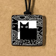 Wide Eyed Black Cat - Ceramic Pendant - Artisan Jewelry by Virginia Miska - black and white by virginiamiska on Etsy https://www.etsy.com/listing/466347968/wide-eyed-black-cat-ceramic-pendant #whitecat