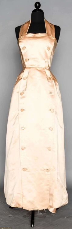 c.1954: Christian Dior Couture Blush pink duchesse satin, halter neck H-Line Ball Gown. Augusta Auctions