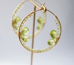 Fun to wear, unique peridot hoop earrings. Easy to wear, the pretty earrings is a great addition to any outfit. Peridot is the birthstone for August  All material is 14k Gold Filled and gemsmtone Please note that peridot drops has natural cracks Hoop measures 1.4 in diameter (3.6cm ) Come in gift box Made to Order  To see all of the jewelry in my store,please visit this link, http://www.etsy.com/shop/Yukojewelry