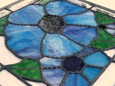 Blue-purple stained glass flowers giving you the taste of