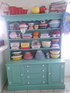 I love this hutch. Beautiful color. Pyrex is cool too!
