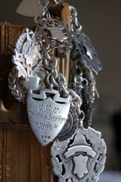 "Bracelet: ""Old English  via Etsy""  Sterling silver with vintage and antique watch fob charms."