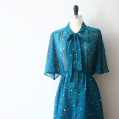 Vintage Japanese Dress 80s Teal Neon Prints Sheer Pussy Bow Dress. $48.00, via Etsy.