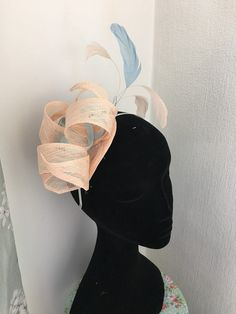 Peach fascinator perfect for summer wedding or races. Made from sinamay ( natural fibres from palm trees ) Colour peach with pale blue ( other colours available for order) Fascinator in ready to dispatch if you need it quickly ( please send me message before purchasing to make sure ) Please check my other hats.