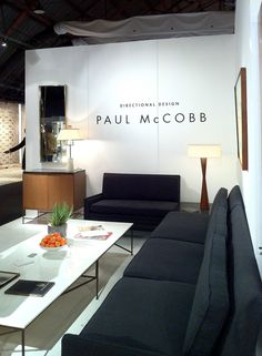 Los Angeles Antiques Show Paul McCobb sectional sofa manufactured by Custom Craft along with an incredibly rare Paul McCobb Brass and Cararra Glass display table manufactured by Irwin Furniture