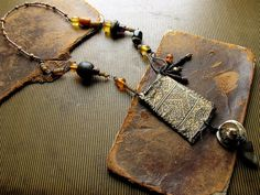 a new sphere  silk and leather talisman pouch by nusquam on Etsy, $73.00