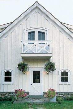 Curb appeal, little deck, hanging baskets, stone foundation