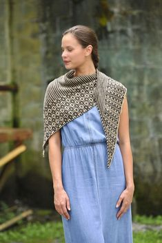 This fun-to-knit, two-color shawl is worked from one point, increasing outward. The body of the shawl is worked in a combination of garter stitch stripes and a mosaic pattern. Find this pattern and more inspiration at LoveKnitting.Com.