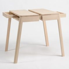 Lovebird tables by Yuki Matsumoto, drawers keeps the two pieces together.