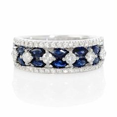 NEW: Diamond 18k white gold ring featuring 14 marquise shaped blue sapphires of exquisite color interspersed with round brilliant cut white diamonds.  $2,295 #love #jewelry #rings